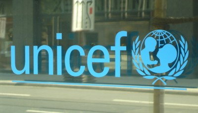 Glass window with unicef logo etching